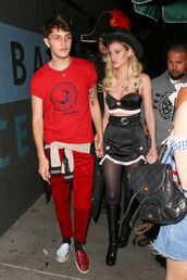skirt,top,bustier crop top,bustier,boots,nicola peltz,halloween,halloween costume,halloween makeup,mini skirt,anwar hadid,celebrity,menswear,mens t-shirt