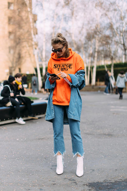 top hun london fashion week 2017 fashion week 2017 fashion week streetstyle orange hoodie denim jeans blue jeans cropped jeans boots white boots ankle boots pointed boots sunglasses jacket blue jacket denim jacket