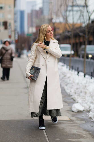 coat nyfw 2017 fashion week 2017 fashion week streetstyle white long coat long coat skirt maxi skirt grey skirt sweater black sweater bag furry pouch pouch sneakers black sneakers vans vans outfits