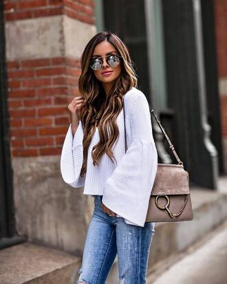 sunglasses black sunglasses sweater white sweater jeans blue jeans handbag brown handbag bag