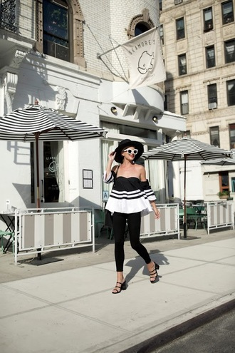 atlantic pacific blogger hat shoes sunglasses black hat black and white off the shoulder white sunglasses black leggings black jeans black heels sandals sandal heels mules strappy sandals strappy shoes striped top spring outfits off the shoulder top striped off shoulder top