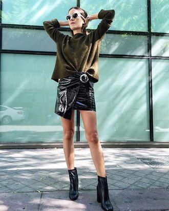 skirt tumblr mini skirt vinyl leather skirt black skirt sweater green sweater wrap skirt asymmetrical asymmetrical skirt boots black boots ankle boots sunglasses outfit idea fall outfits vinyl skirt