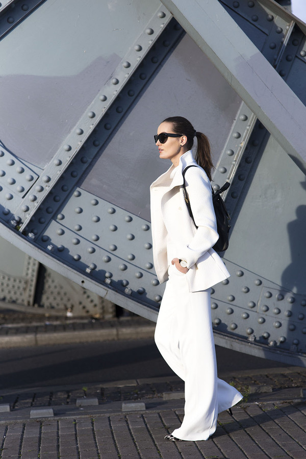 anouska proetta brandon blogger jacket sunglasses white pants flare all white everything minimalist white winter outfit white coat black sunglasses wide-leg pants white pants backpack black backpack