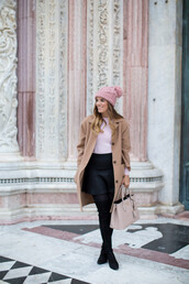 gal meets glam,blogger,sweater,camel coat,pom pom beanie,handbag,dusty pink,black skirt,opaque tights,mini skirt,masculine coat,beige coat