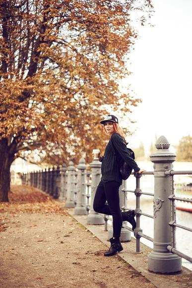 blogger bag black boots knitwear jeans masha sedgwick cap backpack