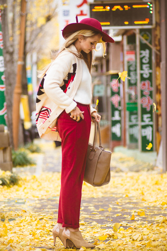 my blonde gal blogger pants cardigan bag hat shoes red winter outfits aztec
