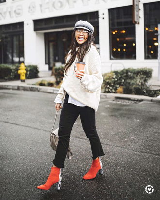 sweater white sweater hat tumblr pants black pants cropped pants boots red boots fisherman cap