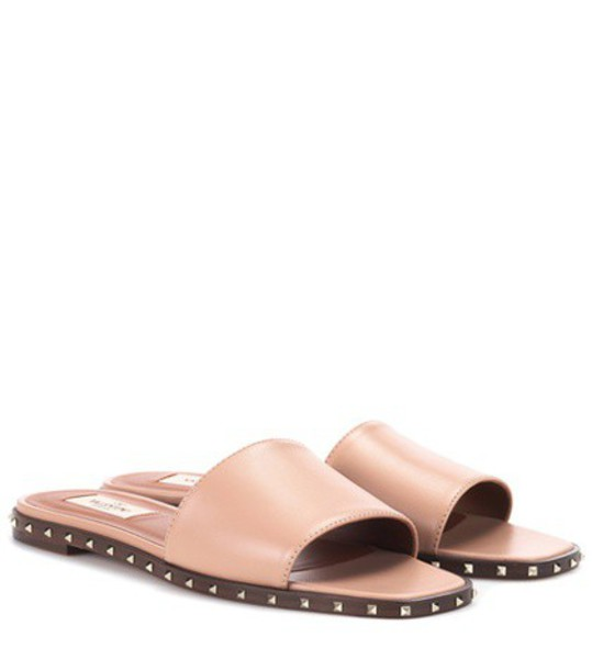 Valentino Garavani Rockstud leather slides in neutrals