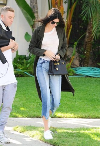 jeans kendall jenner kardashians sneakers sunglasses purse jacket blazer white top green coat skinny jeans black bag mini bag round sunglasses white sneakers