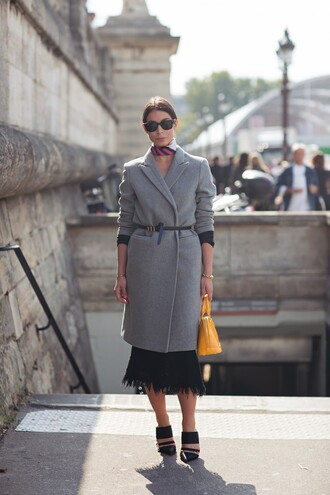a portable package blogger grey coat black skirt