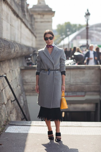 a portable package blogger grey coat black skirt