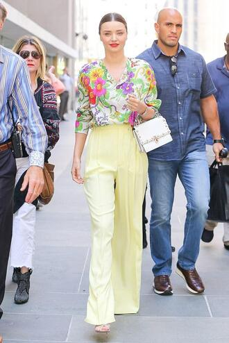 blouse floral floral top nyfw 2017 ny fashion week 2017 pants wide-leg pants yellow miranda kerr model off-duty
