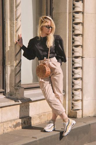 pants beige pants nike black top sneakers white sneakers bag round bag sunglasses