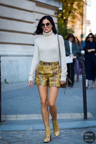 shoes printed boots printed ankle boots ankle boots yellow boots high heels boots snake print shorts yellow shorts sweater turtleneck turtleneck sweater long sleeves nude sweater sunglasses round sunglasses streetstyle fall outfits white turtleneck top snake print ankle boots