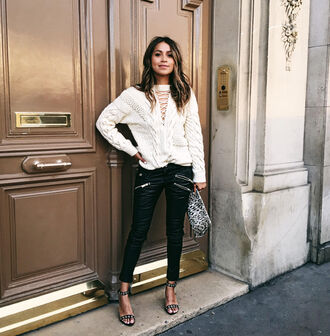sincerely jules blogger lace up leather pants black leather pants cable knit zipped pants black sandals animal print bag spring outfits knitted sweater white cable knit sweater