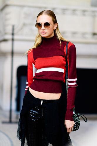 sweater fashion week street style fashion week 2016 fashion week paris fashion week 2016 striped sweater red sweater sunglasses round sunglasses pants black pants cropped sweater streetstyle hairstyles striped turtleneck sweater