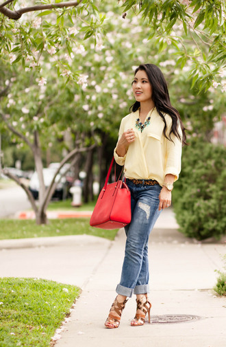 jeans yellow shirt statement necklace red bag ripped boyfriend jeans brown strappy sandals blogger