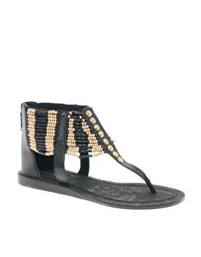 Sandales avec bride ornée de perles à la cheville chez asos