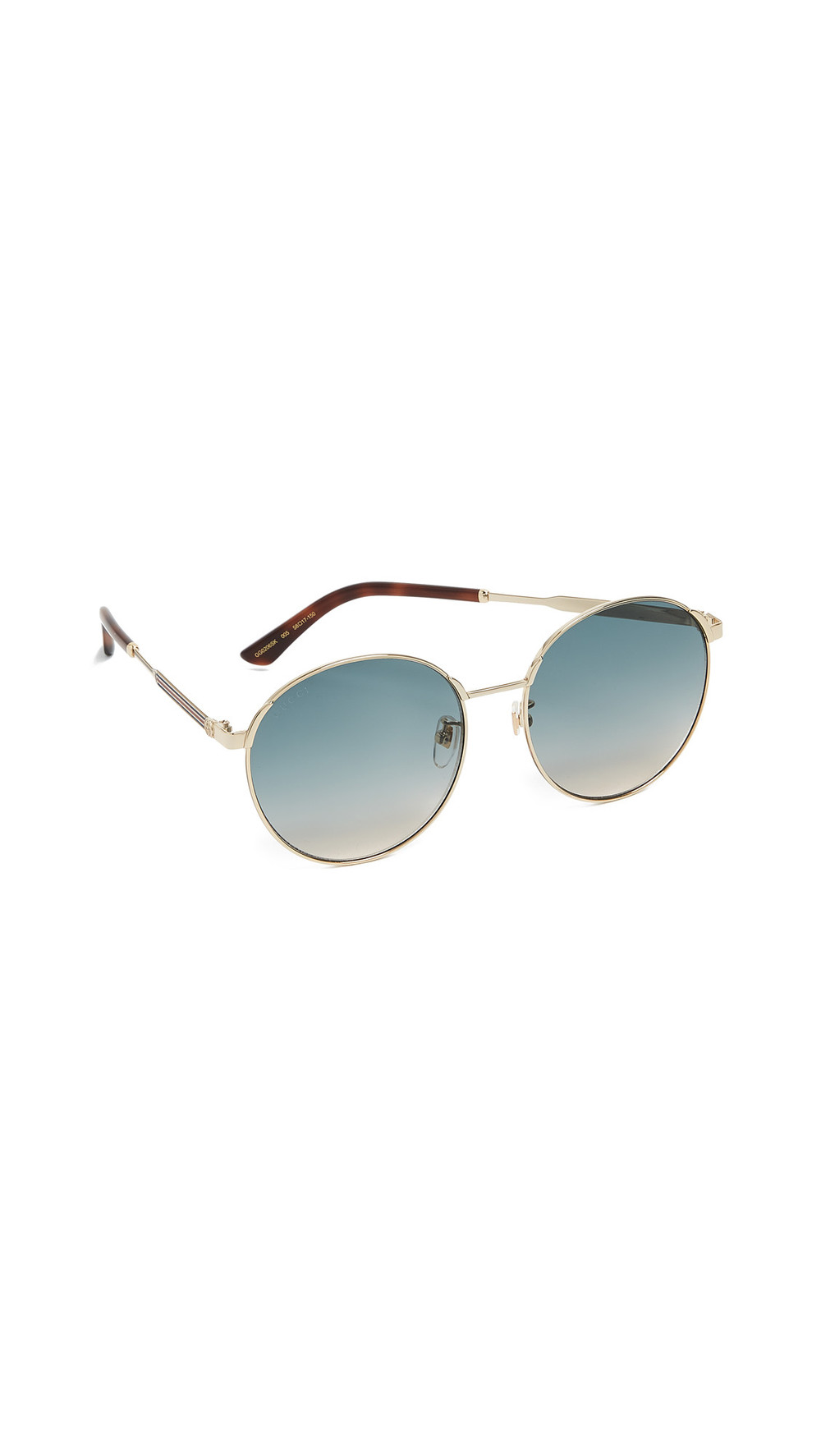 Gucci Sensual Romanticism Round Sunglasses in blue / gold