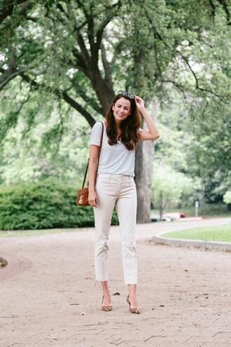 themilleraffect blogger pants t-shirt shoes bag sunglasses pumps crossbody bag spring outfits white pants
