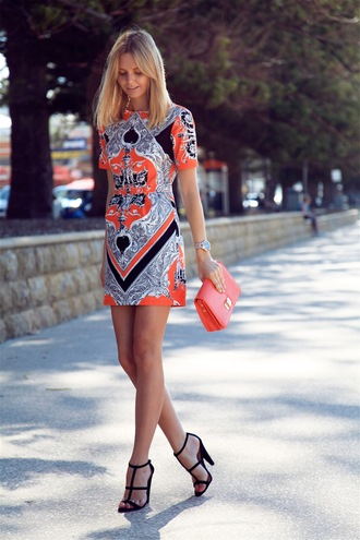 tuula dress shoes bag jewels shift dress multicolor dress cone heels t-strap heels printed dress black heels orange dress short dress orange bag orange clutch blogger exotic print