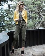 pants,tumblr,top,green top,cropped pants,khaki,khaki pants,mules,shoes,black shoes,jacket,yellow,yellow jakcet,leather jacket,sunglasses