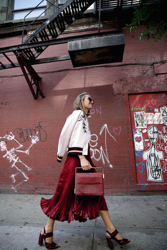 le fashion image blogger jacket t-shirt skirt pleated skirt red skirt red bag bomber jacket red heels high heel sandals tumblr pleated burgundy bag white jacket satin bomber sandals sandal heels red sandals
