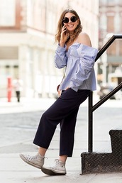 le fashion image,blogger,sunglasses,top,shirt,pants,striped off shoulder top,stripes,striped top,long sleeves,blouse,black pants,cropped pants,round sunglasses,sneakers,high top converse,high top sneakers,white converse,converse,spring outfits,casual friday,stripe shirt