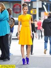 dress,zendaya,yellow,zendaya cute dress and boots,yellow dress,yellow summer dress,cute dress,blue,shoes,blue shoes,heels,high heels,outfit,mustard dress,midi dress,belted dress,short sleeve dress,boots,peep toe boots,peep toe heels,clothes,royal blue heels,jewels,gold,bun,neon,royal blue,royal blue shoes,hair bun