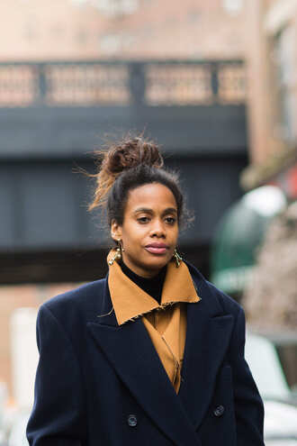 hair accessory nyfw 2017 fashion week 2017 fashion week streetstyle hair bun coat masculine coat navy navy coat earrings gold earrings jewels jewelry gold jewelry