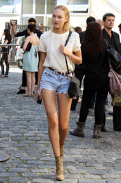shorts,candice swanepoel,model,streetstyle,black bag,top,denim shorts,white t-shirt,belt,blouse,shoes,boots