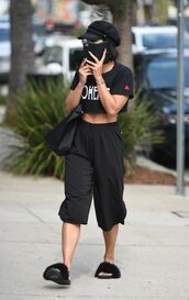 top,pants,all black everything,crop tops,vanessa hudgens,streetstyle,slide shoes,shoes
