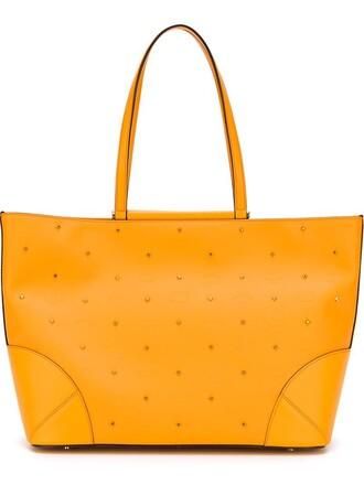 studs yellow orange bag