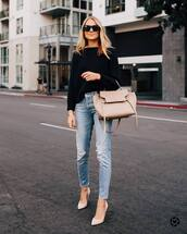 sweater,knitted sweater,jeans,high waisted jeans,ripped jeans,pumps,high heel pumps,handbag,sunglasses,pointed toe pumps,bag,black sweater,black sunglasses