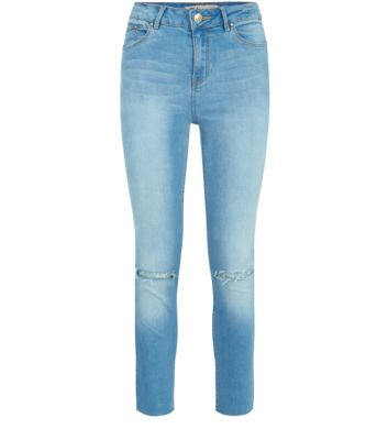 Blue High Rise Ripped Raw Hem Skinny Jeans