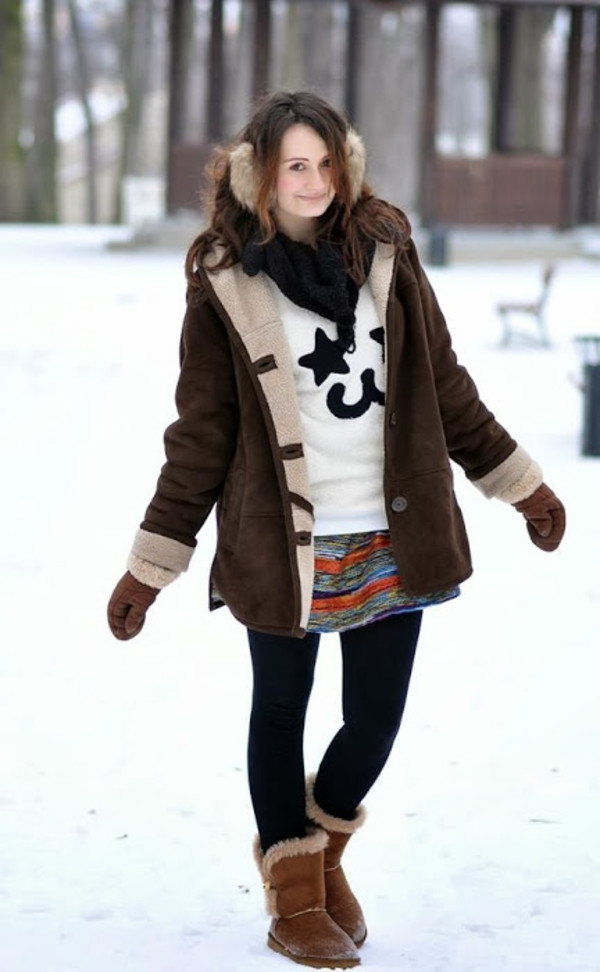 just cleo sweater skirt shoes bag earmuffs brown coat shearling jacket brown shearling jacket shearling mini skirt multicolor tights opaque tights white sweater scarf black scarf boots ugg boots flat boots brown boots winter outfits winter coat winter look