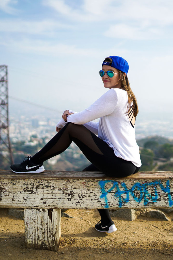 covering bases blogger sunglasses blue cap workout nike sneakers white top leggings mesh leggings black leggings workout leggings nike nike shoes nike running shoes black sneakers cap blue sunglasses top backless open back