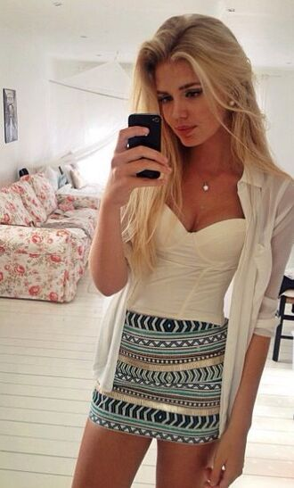 top tribal pattern white dress top white bustier bustier blonde hair model outfit fashionista 20 girly dressy strapless top sweet heart neckline top bralette necklace silver black iphone black phone living room selfie skirt blue patterned skirt blouse jacket aztec