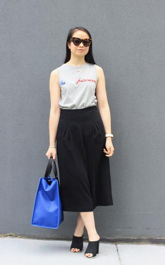 an odd girl blogger top sunglasses bag shoes jewels grey top tank top midi skirt blue bag mules