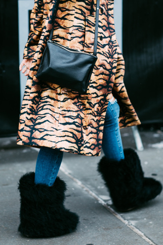 shoes tumblr boots furry shoes black boots winter outfits winter boots winter look coat printed coat fur coat animal print bag nyfw 2017 fashion week 2017 fashion week streetstyle black bag denim jeans blue jeans