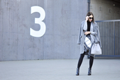 shiny sil,blogger,sunglasses,skirt,bag,black boots,winter outfits,winter coat,grey coat,shoes,jacket,coat,tights,jewels