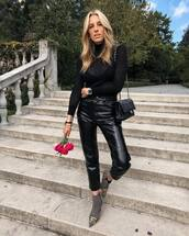 pants,vinyl,cropped pants,high waisted pants,ankle boots,balenciaga,blouse,shoulder bag,watch,shoes,boots,booties,leather pants,black pants,earrings