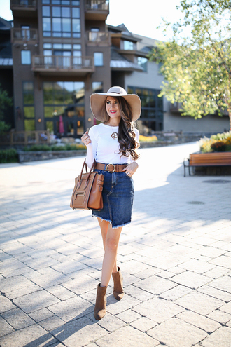 southern curls and pearls blogger t-shirt skirt belt bag shoes hat make-up felt hat nude white top long sleeves denim skirt brown bag mini bag ankle boots brown boots statement necklace