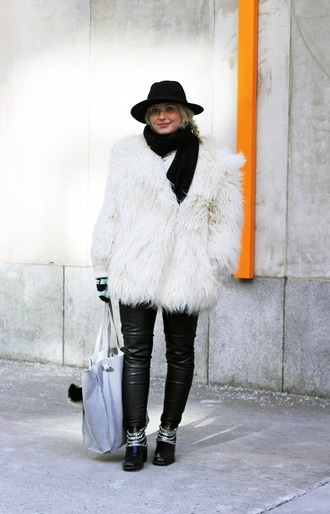 maisie ivy blogger gloves leather pants fluffy fuzzy coat winter outfits white fur coat fur coat white coat big fur coat black hat hat knitted scarf scarf black pants black leather pants black boots chain boots tote bag
