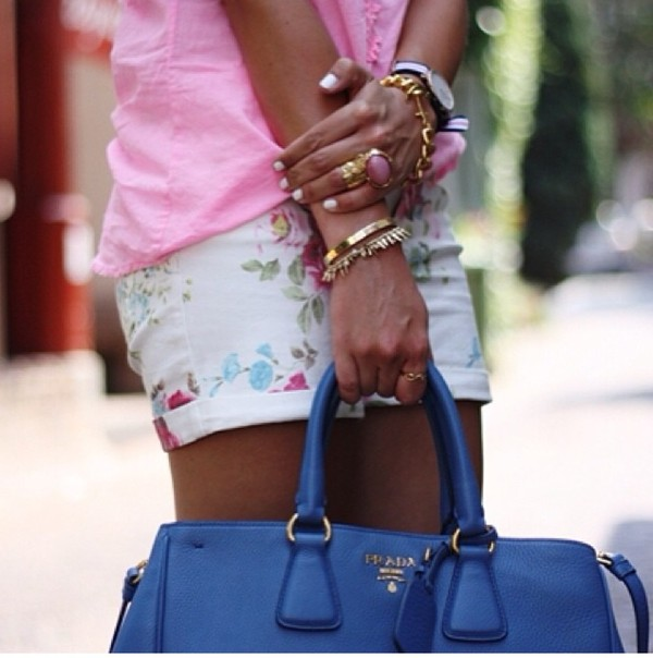 shorts flowers pink blouse summer outfits white jewelry tanned girl nail polish blue bag watch big rings