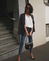 jeans,heels,blue jeans,white top,top,v neck,blazer,black blazer,skinny jeans,high heels,strappy heels,black heels,sunglasses,jacket