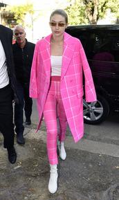 sunglasses,pants,pink,top,boots,coat,gigi hadid,milan fashion week 2017,fashion week 2017,streetstyle,model off-duty