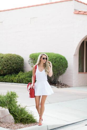 fashion addict blogger red bag white top white skirt