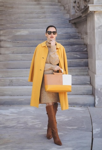 coat yellow coat yellow dress sweater dress knit boots brown boots sunglasses knitted dress