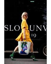 bag,handbag,high heels boots,sock boots,sweater,yellow t-shirt,mini skirt,sunglasses